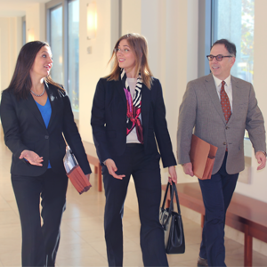 Deputy City Attorneys Megan Cesare-Eastman, Victoria Weatherford and Tom Lakritz walk into Dec. 15 hearing in which the court rejected Kihagi's bid to derail Herrera's lawsuit.