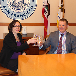 Deputy City Attorneys Mollie Lee and Joshua Milstein celebrate San Francisco's successful legal defense of its century-old Hetch Hetchy Reservoir with a toast of refreshing, pristine tap water.