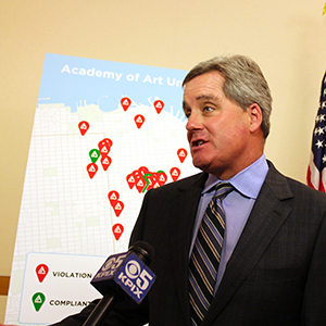 City Attorney Dennis Herrera answering questions about the Academy of Art University lawsuit.