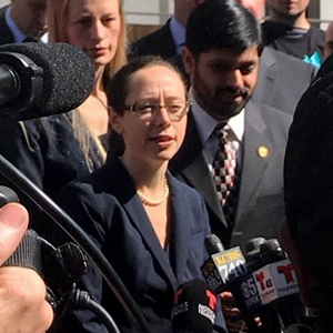Deputy City Attorney Mollie Lee answering press questions outside court after the April 14, 2017 hearing on San Francisco's motion for a preliminary injunction in the city's lawsuit against President Donald Trump's executive order on sanctuary cities.