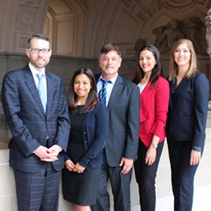 The team that secured a sweeping order and tough injunction against landlord Anne Kihagi, from left to right: Neighborhood and Residential Safety Division Chief Attorney Peter Keith,  Neighborhood and Residential Safety Division Paralegal Carolina Reyes-Ouk, and Deputy City Attorneys Michael Weiss, Megan Cesare-Eastman and Victoria Weatherford.